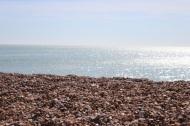 Sea, pebbles, sky