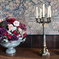 Flower arrangement and candle stick