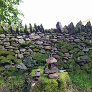 Stone wall and rock formations