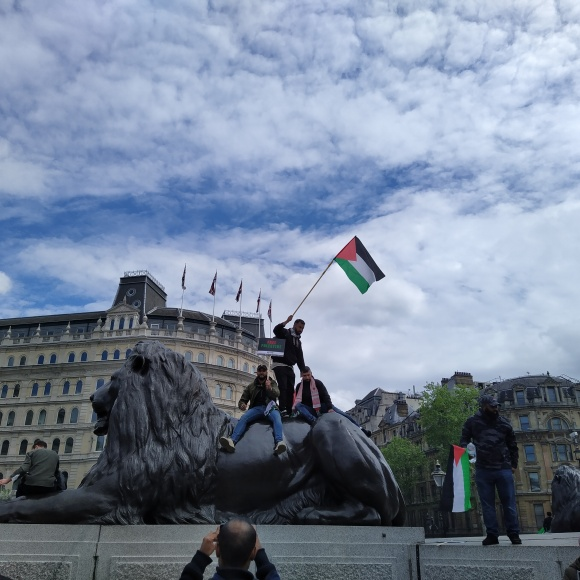 Trafalgar lions and protestors
